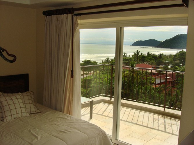 bedroom with an ocean view at a luxury rental in Jaco, Costa Rica