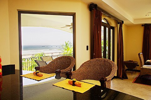 dining and living room with ocean views at a luxury rental in costa rica