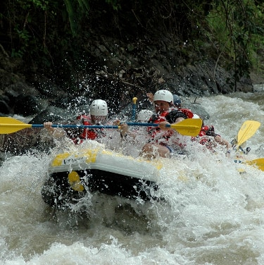 river rafting through rapids