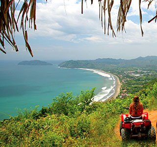 ATV riders overlooking Playa Jaco on an ATV tour
