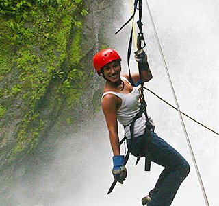 woman on a zip line in Costa Rica