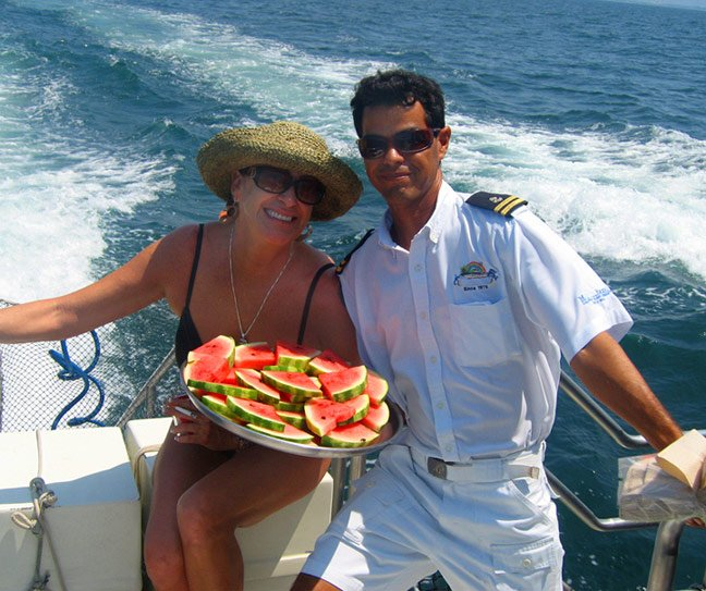 passenger and Tortuga island catamaran crew member