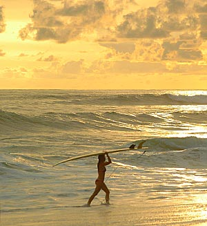 man surfing a wave by Jaco Beach in Costa Rica