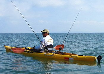 man fishing from a kayak on a tour in costa rica