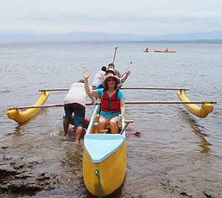 group on an outrigger canoe tour in costa rica