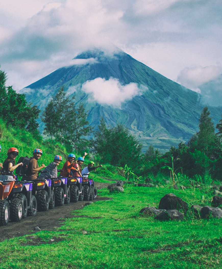 people on an ATV tour before a volcano