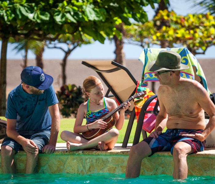child with family members at pool in Costa Rica