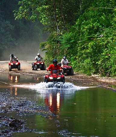 people on a riverbed on an ATV tour in Costa Rica