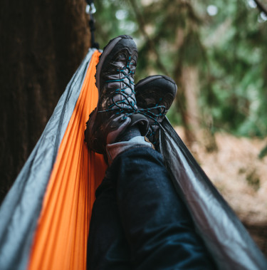 hammock and hiking shoes in forest
