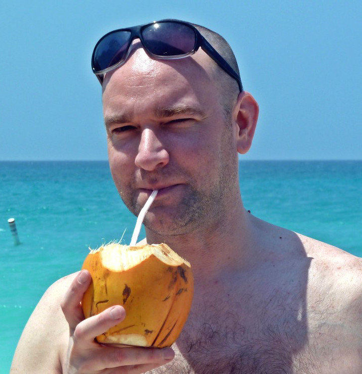 man with a coco loco drink in costa rica