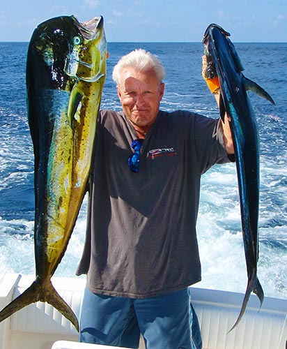 man with fish on costa rica charter boat