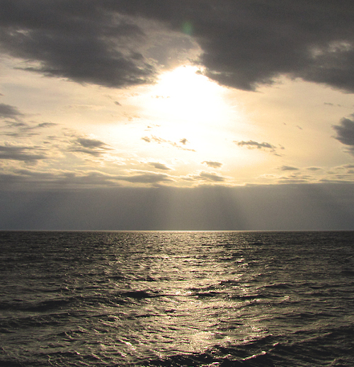 sun over ocean in costa rica
