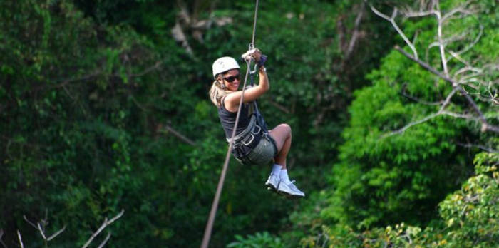 woman on a zipline in costa rica