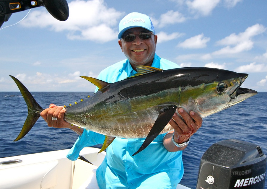 man with yellowfin tuna on fishing trip in Costa Rica