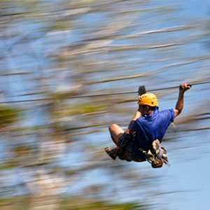 man on a zipline on a Los Suenos Canopy Tour