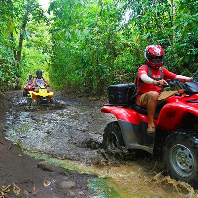 ATV riders taking a rainforest tour in Costa Rica